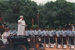 President Dr. Shankar Dayal Sharma receiving the Inter Services Guard of Honour at Rashtrapati Bhavan Forecourt