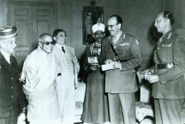 C. Rajagopalachari photographed with General K.M. Cariappa, the new Commander-in-Chief and the outgoing Commander-in-Chief General Roy Bucher at Government House, New Delhi