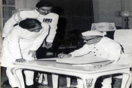 Shri Fakhruddin Ali Ahmed signing the Oath Register after assuming office of the President