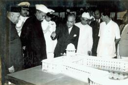 President Dr. Rajendra Prasad being shown a model of the new Supreme Court building, New Delhi